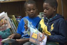 Students received books that are about what they love / RIF donates books to Ensley students