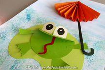frogs. raining. umbrella