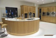 Ex Display Designer Modern Clean-Filled Solid Oak Kitchen / A beautiful solid clean filled oak ex-display kitchen featuring curved units and top of the range Gaggenau appliances. Worktops are Compac Quartz.