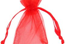 Organza Bags & Organza Pouches / Organza bags are sheer, lightweight and very pretty. They are ideal for packaging your products being sent via the post as they won't increase the weight of the parcel. Very popular for use as wedding favour bags. Available in a range of sizes and colours.  https://www.aplpackaging.co.uk/organza-gift-bags/red.html