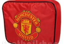 Manchester United / A great selection of Manchester United FC merchandise, apparel, gifts and accessories. Man Utd Christmas gifts and birthday presents are taken care of with our exclusive T-shirts, polo shirts, retro football kits and nightwear. Special occasions such as Father's Day and wedding days are perfect for MUFC ties, wallets, cufflinks, socks & underwear.