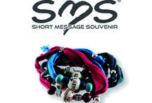 SMS Short Message Souvenir / The SMS charm bracelets, Short Message Souvenir, enhance the importance of the message, an emotional comunication with modern decoration on little majolica hand painted pearls, according to the handicraft tradition of the master ceramists of Deruta.