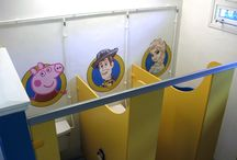 School Washroom Cubicle murals / I was asked to paint a series of characters within the washrooms of a pre-school and childcare Nursery in Snodland, Kent. These character portraits were painted as cameos contained within a porthole. A total of 6 cubicles were painted. Now the WC cubicles are chosen by the children based on their most favoured character.