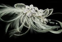 Hair Fascinators / Exclusive hair accessories including hair comb, hair clip made of crystal and pearl and feather at Impostors. We ship Australia wide.