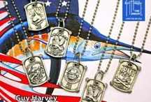Guy Harvey Military Jewelry Collection /  Guy Harvey Jewelry is proud to unveil its new Armed Forces Jewelry Collection, a collectible series of custom designed necklaces for men and women representing all Military branches.  The Army, Air Force, Marines, Navy, Coast Guard and the National Guard are all represented in a stylized pewter dog tag design. These unique designs symbolize love and support for all the men and ladies in our military.    Retail price is $49 each.