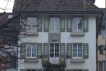 Swiss architecture - shutters, eaves, and timber.