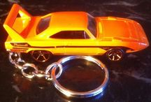 Hot Wheels Keychains Ornaments or Backpack Zipper Pull / Muscle car Hot Wheels on a nice keychain. Ford Mustangs, Pontiac Superbird, GTO, Camaro, and more on a keychain that can be used as an ornament or even a backpack zipper pull. Maybe a light switch string pull for your sons bedroom? The options are many! Bid and buy today!