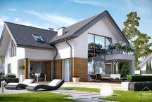 HomeKONCEPT 8 | Projekt domu / Projekt domu HomeKONCEPT-08 wyróżnia przyjemna, rozłożysta bryła oraz niezwykle praktyczne wykorzystanie przestrzeni. Ten komfortowy dom z poddaszem użytkowym jest idealną propozycją dla miłośników nowoczesnych, unikatowych rozwiązań.