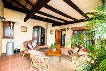 A Touch Of Tuscan / Found on a popular security estate in Wellington this home is positioned in a prime spot on a quiet street. It is apparent almost immediately that this home is a place where you can sit back and relax because as you approach the front door you pass a patio area. Shaded by a roof and some tall foliage this room is sure to be a cool hideaway during Wellington's warm summer months.