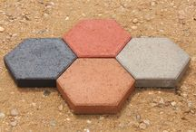 """Hexagon Patio Stones / St. Vrain Block produces Hexagon pavers in several sizes and color options.  We have 14"""" & 18"""" (measured from tip to tip) in Red, Tan, Black, and Grey.  Produced in Dacono, Colorado for more information please call us at 303-833-4144."""