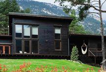 Casa Port del Compte / Casa de montaña de diseño, de tronco laminado, con aislamientos naturales y alta eficiencia energética.