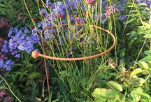 Stakes, Hoops & Semicircular Supports / These chunky stakes are topped with a 40mm ball. They are perfect for staking individual stems such as delphiniums or dahlias  Edging Hoops keep the front of your borders tidy by holding back plants such as alchemilla mollis that flop onto lawns and paths.