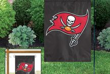 Tampa Bay Buccaneers / Tampa Bay Buccaneers Merchandise is an awesome way to decorate your home & office to create your own Buccaneer fan zone in your bedroom, kid's bedroom, game room, study, kitchen, living room, and even the bathroom. Also magnificent as Tampa Bay Buccaneers fan gifts. Buccaneer Fans - Show off your team spirit today!