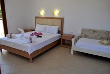 Studios Aspa - Studio 1 / Studio 1 has 3 beds, a double bed and a sofa bed , it is comfortable for 2 adults and a child. There is a fully equipped kitchenette, including toaster, cafetiere and kettle. The kitchenette is recessed and does not intrude into the living space. The living space has the beds and a flatscreen television and leads onto the large, private balcony which is furnished with a dining table, chairs and umbrella.