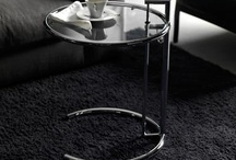 Eileen Gray E1027 Coffee Table  / The table's design and adjustable height make it the perfect bedside table as it can comfortably slide under any bed. Breakfast in bed will never the same again, or as stylish. But the table doesn't have to be limited to the bedroom. It also makes a chic side table for your living room, fitting perfectly alongside sofas and armchairs.