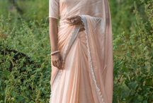 Gentle Deer Pure Satin-Georgette Ribbon Embroidered Saree / PRICE INR15,450; US$234.00 To buy click here https://www.eastandgrace.com/products/gentle-deer-saree Featuring the Gentle Deer pastel orange sorbet pure satin-georgette saree with floral, white lace trim border. The complementing white polka dot printed blouse has an embroidered deer print and ribbonwork flowers and some laurel. The saree comes with the unstitched blended raw-silk blouse material and an unstitched matching lycra-satin petticoat fabric. Reach us: care@eastandgrace.com