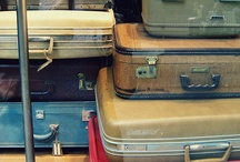 TRAVELING CLOSET / Suitcases.  Lots of them.