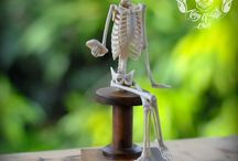 Very Detail Hand Carved Deer Antler Skeleton Sit and Play Phone With Wooden Base