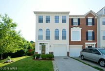 15649 Avocet Loop, Woodbridge VA 22191-5507 / This beautiful 3-finished townhome is conveniently located within walking distance to the VRE, the local shopping center and Potomac Mills Mall. The main level includes a grand two-level foyer, gleaming hardwood floors, a bright open eat-in kitchen with island, stainless steel appliances and pantry.  The  cozy sun room off the dining area looks out onto the deck, and the sun-filled living room with large windows and crown molding rounds out the main level.
