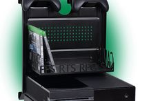 GameSide® / With the wall mount GameSide ® you can finally show your console in a new unique and innovative exhibit also  with LED LIGHT. With the GameSide® wall mount you can place your console easy and secure at the wall next to your TV or monitor and plug all the cables and any power supply on the back so there will be no more tangles in sight! It installs easily to the wall with 4 plugs supplied .