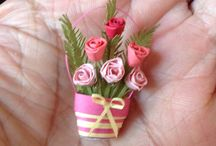 Miniature paper roses in a basket
