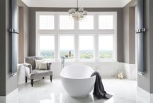 Luxury Master Ensuite / This show-stopping bathroom sits inside a beautiful Victorian home. The designer at Ripples worked with the homeowner to create a luxurious haven. The master ensuite features a freestanding bath, marble-effect porcelain tiles, a bespoke vanity unit and a luxury walk-in shower. The brief was a glamorous bathroom that was also an indulgent space to relax in. The designer positioned the bath in the window to make the most of the home's incredible views.