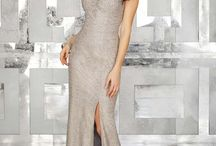 Evening Gowns F'17 | Morilee by Madeline Gardner / In our Morilee Evening Dress collection, designed by the Madeline Gardner, you'll find gorgeous and sophisticated dresses for all tastes, styles and moods. We have tea length and long flowing cuts, slinky figure-flattering dresses with provocative silhouettes, sweeping skirts with daring necklines. You'll find plush seductive materials — silky crepe, creamy chiffon, luxurious organza, alluring lace. You will swoon over the intricate beading, the delicate embroidery, the sensual lace appliqué.
