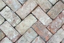 Reclaimed Belgian Red Bricks for Hearths, Fireplace Surrounds and Focal Point Walls / Belgian Reclaimed Red Bricks are like your favorite stone washed denim jeans; soft to the eye with a perfectly worn appearance.  The soft color palette of these red bricks means less red saturation which helps a focal wall or fireplace stand out in texture but not necessarily in saturated color.  This helps an overall design when these architectural elements are authentically fabulous yet still remain a team player.