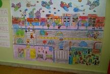 LA CALLE/ EL BARRIO / Mural construido a base de dibujos coloreados por el alumnado, recortados y pegados hasta construir una ciudad para la unidad de la calle