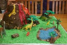 Vulcano birthday cake in Jurassic park / My grandson wanted a vulcano birthday cake and he wanted to add his beloved dinosaurs.  A great team effort resulted in this epic cake!