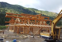 Kamloops, BC / This magnificent log shell has just been reassembled on site north of Kamloops BC by Sitka log homes. Log walls and posts are Western red cedar and massive roof beams are D-fir. Customer pre-stained the roof beams at ground level before reassembly to minimize the work up high. The wrap around decks have log rafters 4' apart with 2x6 T&G decking on top. Gazebo and outdoor dining arbour still have to be reassembled on view side to river.