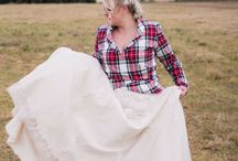 Samantha Joubert's Scottish Wedding / Samantha married Ray, in wintry Dullstroom in a stunning Scottish wedding in May 2017. Dimity created a sash made from Ray's family tartan which followed a Scottish wedding tradition. We also developed the double-sided hand-tying ribbon featuring both the bride and groom's family tartans. Samantha asked Dimity to design her a jacket from her family's tartan. The jacket featured ballet-wrap styling and a shawl collar to finish off her bridal look.
