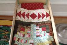 Herman's dollbed / A little quilt with log cabin and flying geese. A happy boy!