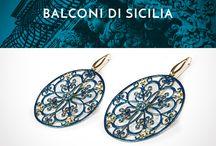 Balconi di Sicilia / Le linee morbide dei balconi in ferro battuto si stagliano nell'azzurro del cielo. Un omaggio alla luce e ai motivi decorativi del Barocco di Sicilia.