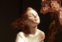 Scultupted Beauty / Women sculpted using different art mediums. / by De Ann Price