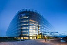 Rambøll Head office / Four years of work have resulted in one of Denmarks largest and most dramatic corporate head quarters, the Ramboll Head Offices, RHO. This 40,000 sq m office is now the daily workplace for 1,800 employees, yet every detail has been designed to reflect and underpin Rambolls encompassing vision of innovation, collaboration and knowledge transfer.