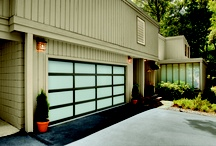 Modern Garage Doors / The modern, industrial look goes residential with the Amarr Vista Aluminum Full View Collection. From the outside, these sleek doors perfectly mirror the clean lines and glass expanses of your home's contemporary design. Inside, they transform your garage into a bright and inviting room.