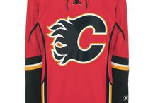 Calgary Flames - Official NHL Hockey Jerseys / We are the leading manufacturer of professional sports lettering & numbering and we have been selling officially licensed NHL jerseys and apparel via the internet since 1999. Visit: CoolHockey.com for more!