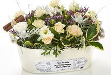 Trugs & Planters / New flower-filled rustic trugs tied with satin ribbon labels make perfect year-round gifts. Beautifully made in natural wood, they can be reused for picking flowers.  New metal country planters are made to last with freshly picked flowers and foliage with personalised labels for a statement gift.