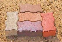 """Interlocking Paving Bricks aka. IPB / St. Vrain Block's premiere Serpentine """"S"""" Interlocking Paving Brick adds a unique finish to any walkway, patio, or driveway.  They are 3 1/8"""" X 4"""" X 8"""" in dimension and can withstand the force of a car driving on them.  We produce this product right here in Dacono Colorado and can be found at www.stvrainblock.com  //  303-833-4144"""