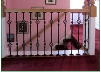 Landing Refurbishment / Our customer wished to change his landing of 45 years. Charleston and Edisto metal spindles were used with oak handrails and baserails. The newel caps are our customer's own.