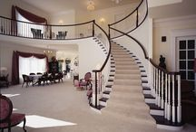 Traditional Staircase / Arcways TRADITIONAL curved stairways follow a broad spectrum of historical faithful influences. Our freestanding and wall supported stairways can be completely customized with custom shaped (not bent) handrail profiles; helical descending volutes with barrel bases; carved skirt brackets; stone treads & risers; hand carved balusters from Spain; hammer forged custom iron railings and more.