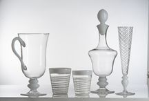 """Isola Collection / Isola, meaning """"island"""" in Italian, is a light and breezy glassware collection with cool, crisp whites and bold, bright color accents. These pieces add a touch of sunshine to any table setting."""