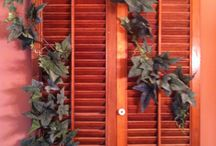 One persons trash = my TREASURE!  / Shutters bought at Thrift Store $1.50 and Ivy from Dollar Tree $1.00