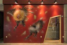 "Gonpachi_焼鳥と魚貝の店 ごんぱち / LSD design co., ltd. ""Gonpachi""/2014/Japanese dining/Oita, Japan/interior and facade design wall painting, red, gold, yakitori, split-roasting"