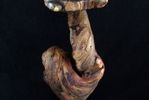 Art Sculpture Pedestal Display Stand / This rustic yet modern log table was made for an art sculpture/bust. The table top and base is made from burled pine with beautiful bluing in the coloring, which darkened to almost black when it was oiled. The pedestal itself is made from twisted pine, it was not sanded and polished but left natural.