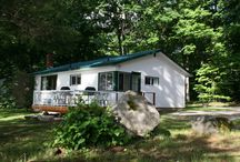 Centennial / Located half way down the Cottage Road, Centennial is a four bedroom cottage featuring a large kitchen, 1.5 bathrooms, wood fireplace, private deck, dock and campfire pit.