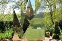 TeePee / A 7 foot (2m) high sculpture in interlinked stainless steel triangles. It is set on a 5 foot (1.5m) circular base, with a back plate where it may be positioned against a wall. A fountain is set inside the TeePee, with three intersecting water jets.