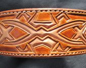 Custom Leather Dog Collars / Hand tooled leather dog collars is what I specialize in humbly said. I have great times working with clients bringing their dreams, visions, favorite patterns and colors to life.