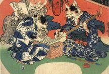 Bakeneko - Nekomata / le bakeneko est un chat ayant des pouvoirs surnaturels qu'il acquiert en atteignant l'une (ou plusieurs) de ces caractéristiques : un âge de treize ans, un poids de plus d'un kan (unité de poids japonaise qui correspond environ à 3,5 kg) ou une très longue queue. Il arrive parfois que celle-ci se divise en deux, faisant alors du bakeneko un nekomata (猫又?). (wikipedia)